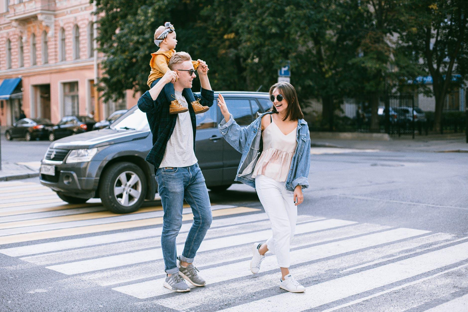 a photo of a family walking in pedestrian lane
